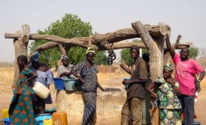6886675 - wassadou,senegal - february 13,2007 : all the people working in the extraction of water from the well in the peul ethnic village.